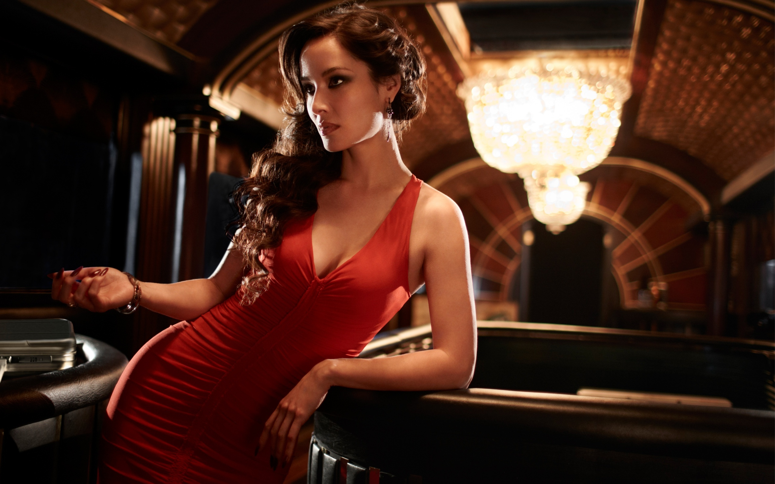 Severine (in a red dress) - Skyfall